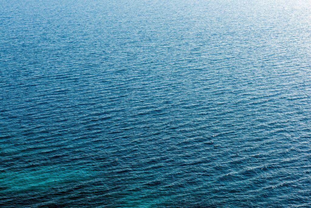 Sea water surface texture. Deep sea waves